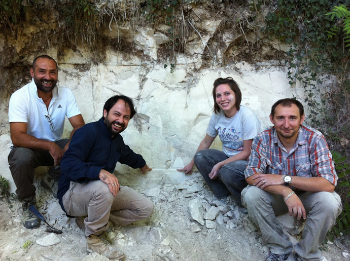 The international team of scientists sitting next to an outcrop in the Sulmona basin of the Apennine Mountains that contains the Matuyama-Brunhes magnetic reversal. (Photo by Paul Renne, from press-release of the University of California, Berkeley)