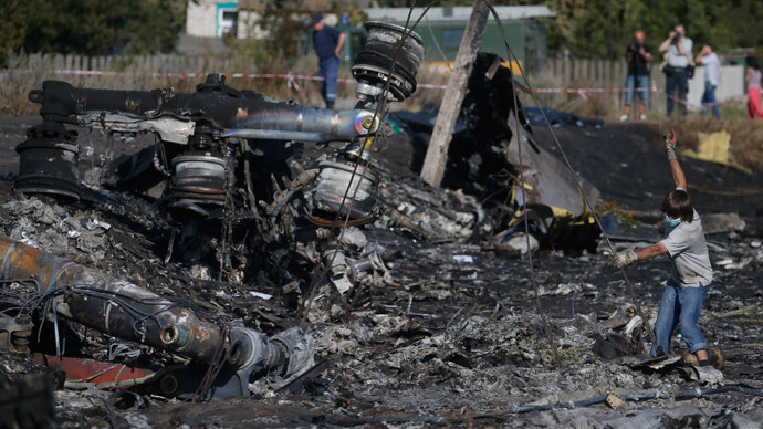 Dutch PM: Investigators access MH17 crash site, collect more remains