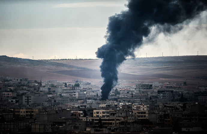 Smoke rises from the Syrian town of Kobani, also known as Ain al-Arab, as it is seen from the southeastern village of Mursitpinar, Sanliurfa province, on October 19, 2014. (AFP Photo / Bulent Kilic)