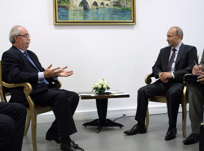 Total CEO Christophe de Margerie with Russian President Vladimir Putin in Paris on June 11, 2010. (AFP Photo / RIA Novosti / Pool / Alexei Nikolsky)