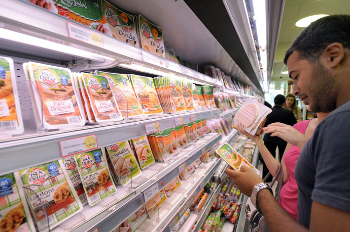 Customers look at food products in a department of a 100% halal food shop, the Hal'Shop, in Nanterre, a western suburb of Paris. (AFP Photo / Miguel Medina)