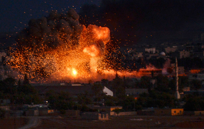 Flames rise following an explosion in the Syrian town of Kobani, also known as Ain al-Arab, as seen from the southeastern Turkish village of Mursitpinar in the Sanliurfa province on October 20, 2014. (AFP Photo / Bulent Kilic)
