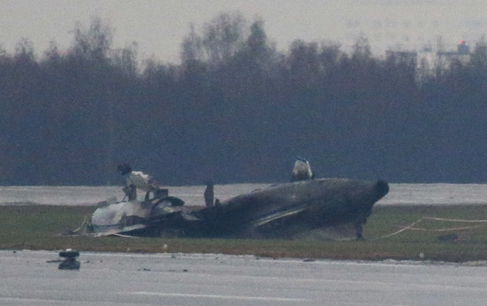 The wreckage of what is believed to be Christophe de Margerie's Dassault Falcon jet is seen at Moscow's Vnukovo airport, October 21, 2014. (Reuters/Maxim Zmeyev)