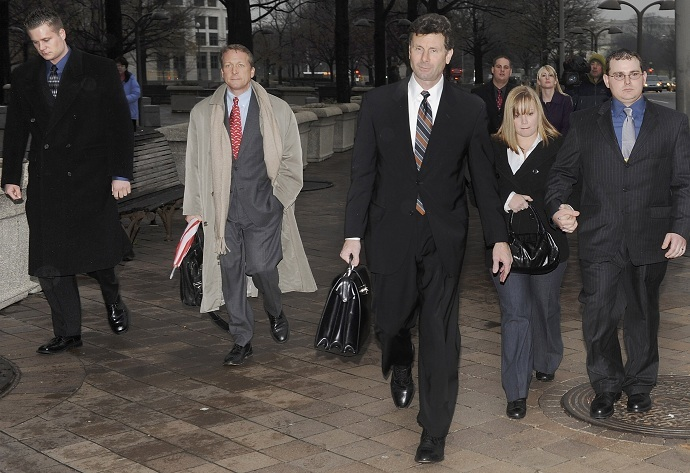 Former Blackwater Worldwide security guards Donald Ball (2nd L) and Dustin Heard (R) leave the federal courthouse with their legal team after being arraigned (Reuters/Jonathan Ernst)