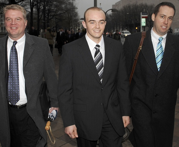 Former Blackwater Worldwide security guard Nick Slatten (C) and attorneys after he was arraigned (Reuters/Jonathan Ernst/Files)