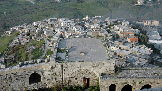 A handout picture released by the official Syrian Arab News Agency (SANA) on March 21, 2014, shows a general view of part of the Krak de Chevaliers castle overlooking al-Hosn village in the Homs region, about 200 kms northwest of the capital Damascus (AFP Photo / SANA)