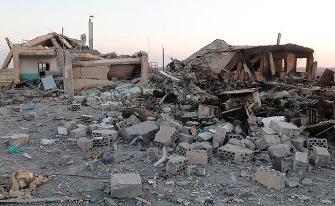 A general view shows a damaged school that was targeted on Monday by what activists said were U.S.-led air strikes, at Ain al-Arous town in Raqqa governorate October 1, 2014 (Reuters / Stringer)