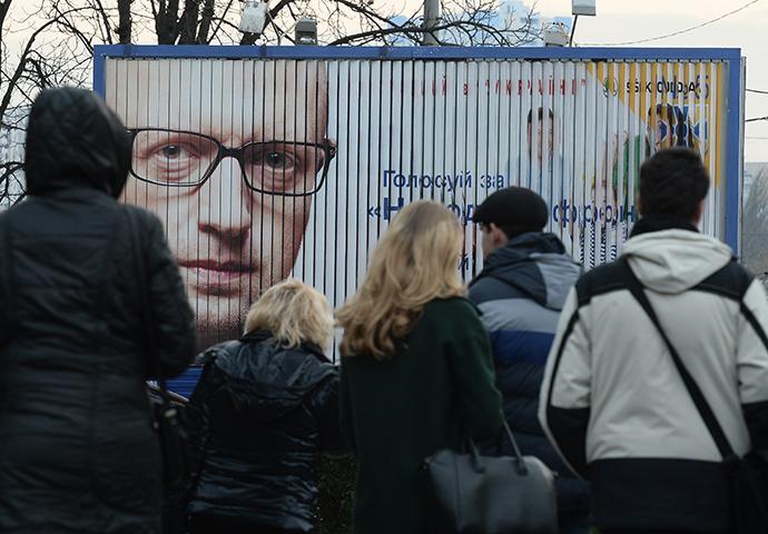 Campaign poster with the Ukraine's Prime Minister Arseny Yatsenyuk in Kiev (RIA Novosti / Maksim Blinov)