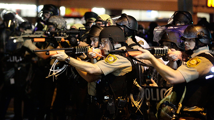 'Fighting effects of tear gas': Amnesty says Ferguson cops violate basic human rights