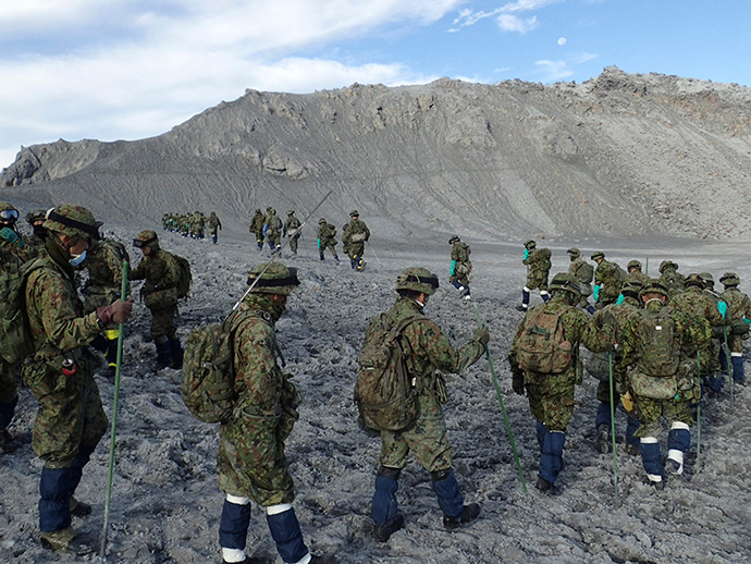 Japan Self-Defense Force (JSDF) soldiers conduct rescue operations near the peak of the Mount Ontake, which erupted September 27, 2014 and straddles Nagano and Gifu prefectures, central Japan, in this handout photograph released by Joint Staff of the Defence Ministry of Japan and taken October 11, 2014 (Reuters / Joint Staff of the Defence Ministry of Japan)