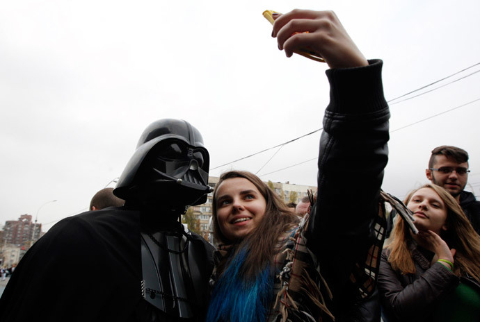 "A candidate, presenting himself in the character of ""Star Wars"" villain Darth Vader and representing the Internet Party of Ukraine which runs for parliament, poses for a picture during a meeting with his supporters and voters in Kiev, October 22, 2014.(Reuters / Valentyn Ogirenko )"