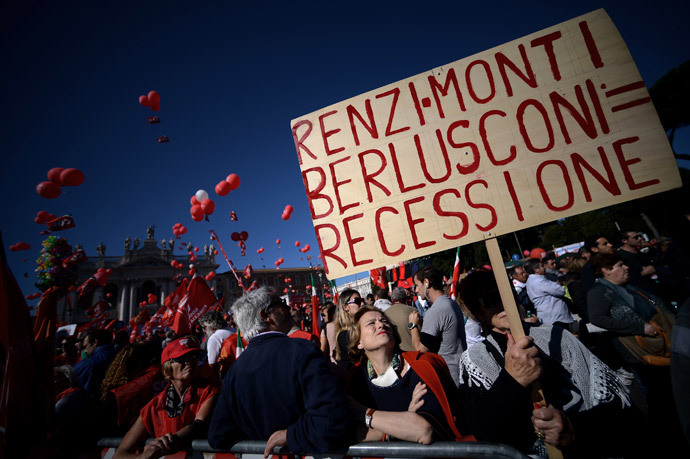 "A woman holds a banner reading ""Renzi-Monti-Berlusconi = recession"" during a demonstration organised by Italian General Confederation of Labour (CGIL) union on October 25, 2014 in central Rome.(AFP Photo / Filippo Monteforte)"