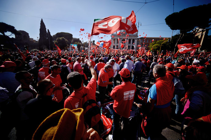 Italian General Confederation of Labour union (CGIL) workers gather for a rally in central Rome's San Giovanni Square on October 25, 2014 as part of a nationwide demonstration called to protest Prime Minister Matteo Renzi's plans to overhaul the labour market.(AFP Photo / Filippo Monteforte)