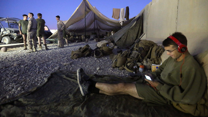 A U.S. Marine listens to music before their withdrawal from the base, at Camp Bastion in Helmand province October 25, 2014.(Reuters / Omar Sobhani)