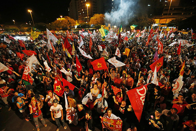Supporters of Brazil's President and Workers' Party (PT) presidential candidate Dilma Rousseff react to first results of the Brazil general elections in Porto Alegre, October 26, 2014. (Reuters/Paulo Whitaker)