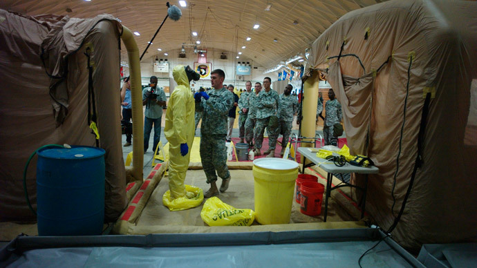 A U.S. Army soldier from the 101st Airborne Division (Air Assault), who are earmarked for the fight against Ebola, goes through decontamination process training before their deployment to West Africa, at Fort Campbell, Kentucky (Reuters / Harrison McClary)