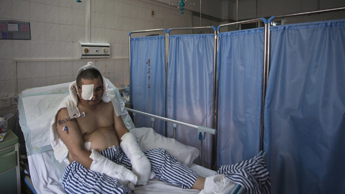 Li Jianxin, a blogger and online whistleblower, lies on a bed waiting for a fourth operation at a hospital in the southern Chinese city of Huizhou, Guangdong province July 23, 2013. (Reuters/Tyrone Siu)