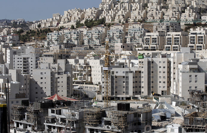 A partial view taken on October 29, 2014 shows cranes used to construct new buildings in the Israeli settlement of Har Homa, which was originally built in the 1990s, in the annexed Arab east Jerusalem area of Jabal Abu Ghneim. (AFP Photo/Ahmad Gharabli)