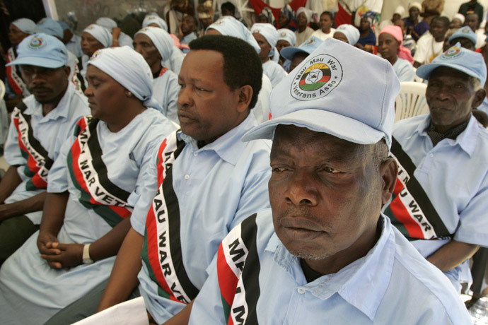 Members of the Kenya Mau Mau freedom fighters association gather to witness the official unveiling of a bronze statue monument of their hero Dedan Kimathi in Nairobi February 18, 2007. (Reuters/Antony Njuguna)
