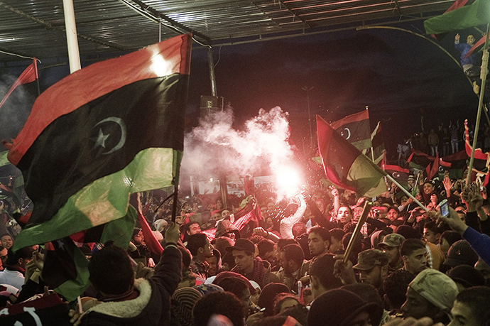 Libyans wave their new national flag as they celebrate the 1st anniversary marking the start of the uprising against Moamer Kadhafi in Freedom Square in the eastern city of Benghazi on February 17, 2012 (AFP Photo)
