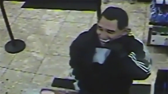 Obama impostor robs Dunkin' Donuts with mask & gun (VIDEO)