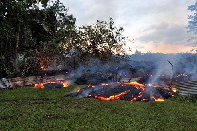 This October 28, 2014 image provided by the US Geological Survey(USGS) shows the lava that has pushed through a fence marking a property boundary above Pāhoa in Hawaii. (AFP Photo)
