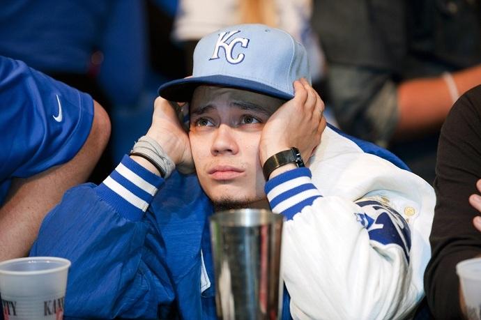 A Kansas City Royals fan reacts to the team's loss at baseball's World Series against the San Francisco Giants (Reuters/Sait Serkan Gurbuz)