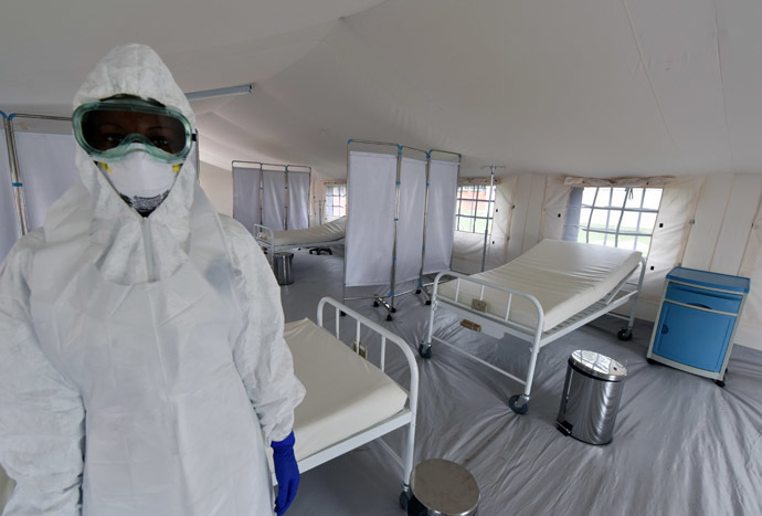 A health worker poses inside a tent in the Ebola treatment unit being preventively set to host potential Ebola patients at the University Hospital of Yopougon, on October 17, 2014. (AFP Photo)