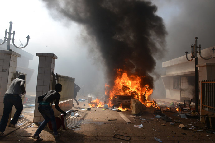 Prostestors enter the parliament in Ouagadougou on October 30, 2014. (AFP Photo/Issouf Sango)
