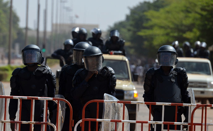 Riot police cordon off access to the parliament on October 29, 2014 in Ouagadougou as people demonstrate against the high cost of living in Burkina Faso. (AFP Photo/Issouf Sango)