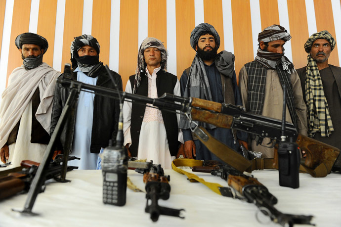 Former Taliban fighters stand with their weapons during a reconciliation process in Herat province (AFP Photo)