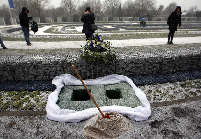 wo graves are pictured at a specially designed cemetery for Schalke 04 fans during its opening ceremony near the football stadium in Gelsenkirchen December 7, 2012. (Reuters/Ina Fassbender)
