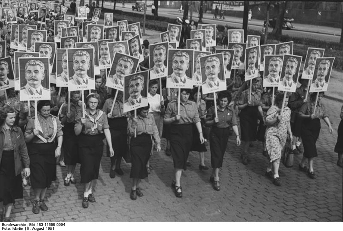 German students carry posters of Joseph Stalin for a youth parade in 1951 (image from wikimedia.org)