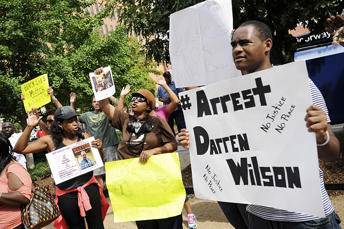 Protestors at the St. Louis County Justice Center call for the arrest of Police Officer Darren Wilson in Clayton, Missouri August 20, 2014. (Reuters/Mark Kauzlarich)