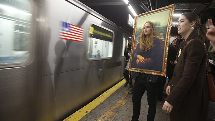 A participant in the Village Halloween Parade dressed as the Mona Lisa waits to ride the subway after the parade in the Manhattan borough of New York October 31, 2014. (Reuters/Carlo Allegri)