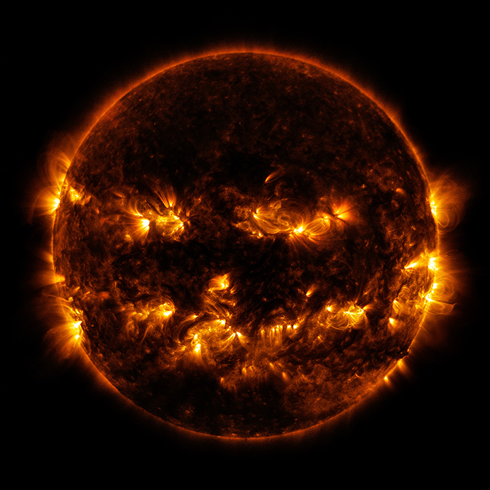 This NASA image obtained October 10, 2014 shows active regions on the sun as they gave it the appearance of a jack-o'-lantern. This image was captured by the Solar Dynamics Observatory on October 8, 2014 (AFP Photo / NASA)