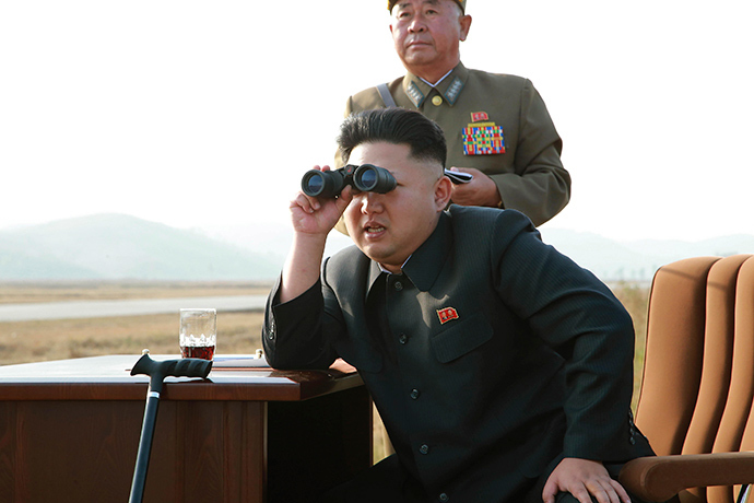 North Korean leader Kim Jong Un looks through a pair of binoculars as he guides a flight drill for the inspection of airmen of the Korean People's Army (KPA) Air and Anti-Air Force in this undated photo released by North Korea's Korean Central News Agency (KCNA) in Pyongyang October 30, 2014 (Reuters / KCNA)