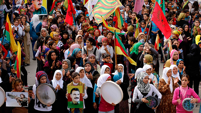 Global day for Kobani: Thousands march to support Kurds' fight against ISIS