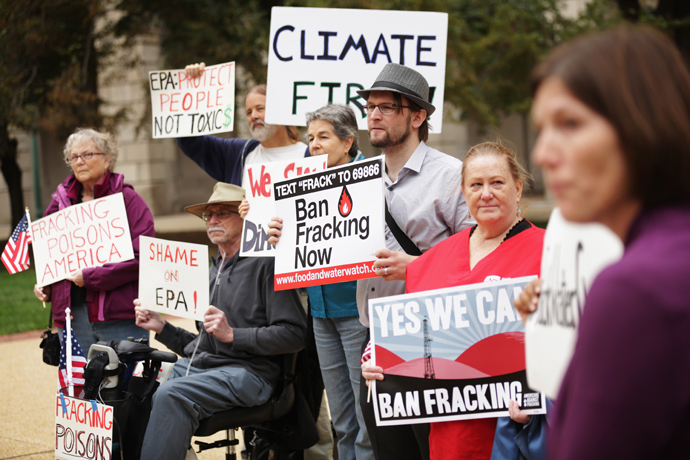 Affected community members from Dimock, Pennsylvania hold signs during a rally on fracking-related water investigations October 10, 2014 outside EPAs Headquarters in Washington, DC. (Alex Wong / Getty Images / AFP)