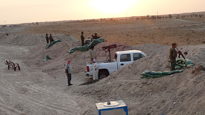 'Women and children dumped in a well': ISIS massacres 322 Sunni tribesmen in west Iraq