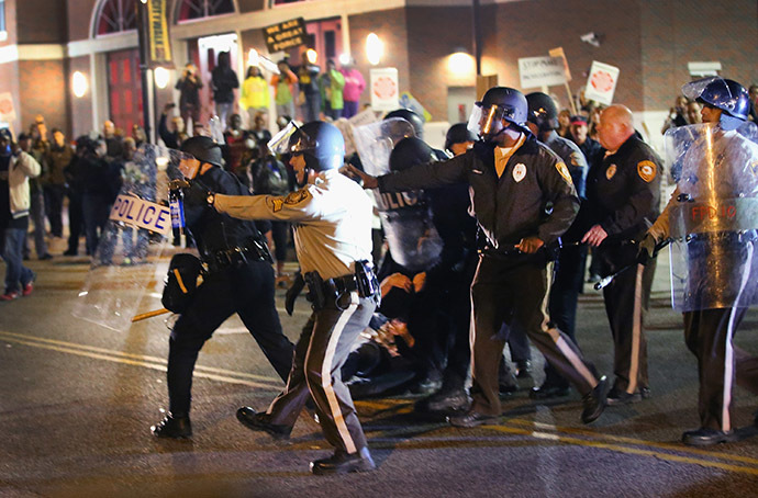 Police face off with demonstrators outside the police station as protests continue in the wake of 18-year-old Michael Brown's death on October 22, 2014 in Ferguson, Missouri. (AFP Photo/Scott Olson)