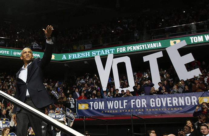 U.S. President Barack Obama waves before he speaks at a campaign event for Tom Wolf, who is running for Governor of Pennsylvania, while in the Liacouras Center at Temple University in Philadelphia, November 2, 2014. (Reuters/Larry Downing)