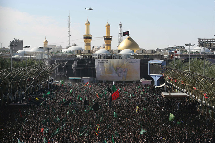 Iraqi Shiite Muslims gather outside the shrine of Imam Hussein -one of Shiite Islam's most revered figures- during the Ashura commemorations that mark his killing on November 4, 2014. (AFP Photo/Mohammed Sawaf)