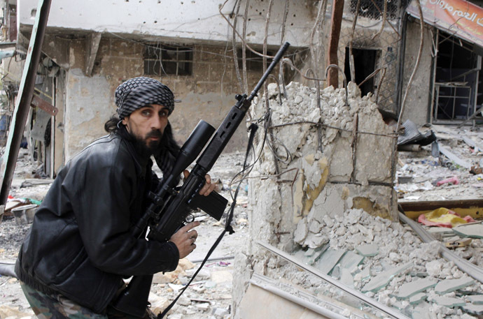 A rebel fighter from the Free Syrian Army holds a position with a Belgium made FAL rifle at a front line in the Salah al-Din neighbourhood of the northern Syrian city of Aleppo (AFP Photo)