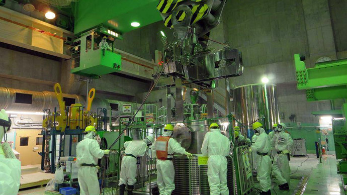 Workers at Reactor 4 building. Photo by Tepco.