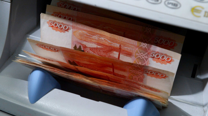 Russian ruble plunges as Central Bank announces limit to intervention