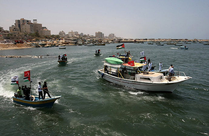 "Palestinian Hamas policemen patrol off the coast of Gaza City on May 29, 2010 in preparation for the arrival of the ""Freedom Flotilla"". (AFP Photo / Mahmud Hams)"