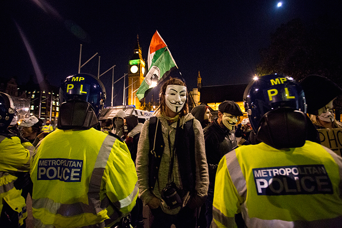 "Anti-capitalist protesters wearing Guy Fawkes masks take part in the ""Million Masks March"" in Parliament Square in London on November 5, 2014. (AFP Photo / Jack Taylor)"