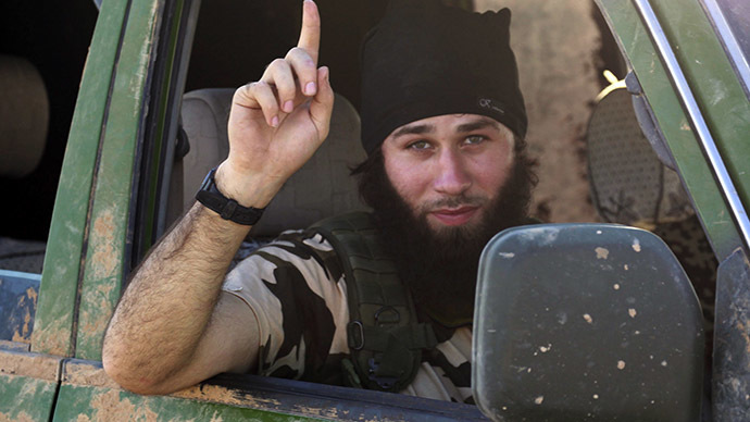 An Islamic State fighter gestures from a vehicle in the countryside of the Syrian Kurdish town of Kobani, after the Islamic State fighters took control of the area October 7, 2014. (Reuters / Stringer)