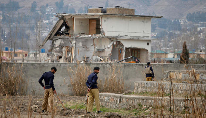 Policemen stand guard near the partially demolished compound where al Qaeda leader Osama bin Laden was killed by U.S. special forces, in Abbottabad February 26, 2012.(Reuters / Faisal Mahmood)